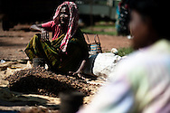 Tribal women sell a root that is used to make distilled alcohol at a market in the state of Chhattisgarth in India October 16, 2009. The market is one of the only opportunities where tribal residents of the area can buy and sell good need for survival such as produce, textiles, and other goods in the state where a Maoist movement has brought violence and a disruption of government. The Indian government has begun to increase it's presence of police and military in Naxal dominated states such as Maharastra and Chhattisgarth in response to recent levels of violence by Naxals including an incident where an ambush killed 17 state police.