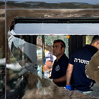An Israeli forensic police officer inspects the scene of a shooting attack in Jerusalem, Tuesday, Oct. 13, 2015. A pair of Palestinian men boarded a bus in Jerusalem and began shooting and stabbing passengers, while another terrorist rammed a car into a bus station before stabbing bystanders, in near-simultaneous attacks. <br /> Photo by Olivier Fitoussi.
