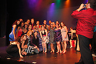 WSU seniors stop for a group photos as students and patrons turn the main stage into a dance club after the final performance of Hairspray during the 13th Annual ArtsGala at Wright State University's Creative Arts Center, Saturday, March 31, 2012.