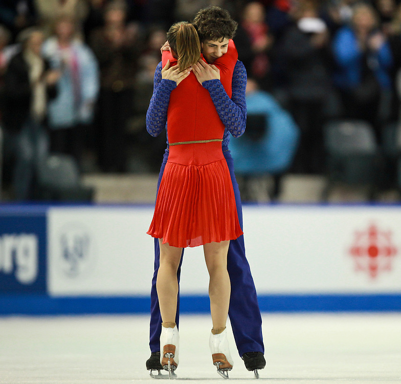 20101031 -- Kingston, Ontario -- Gold medalists Vanessa Crone and Paul Poirier of Canada embrace following their free dance at Skate Canada International in Kingston, Ontario, Canada, October 31, 2010. <br /> AFP PHOTO/Geoff Robins
