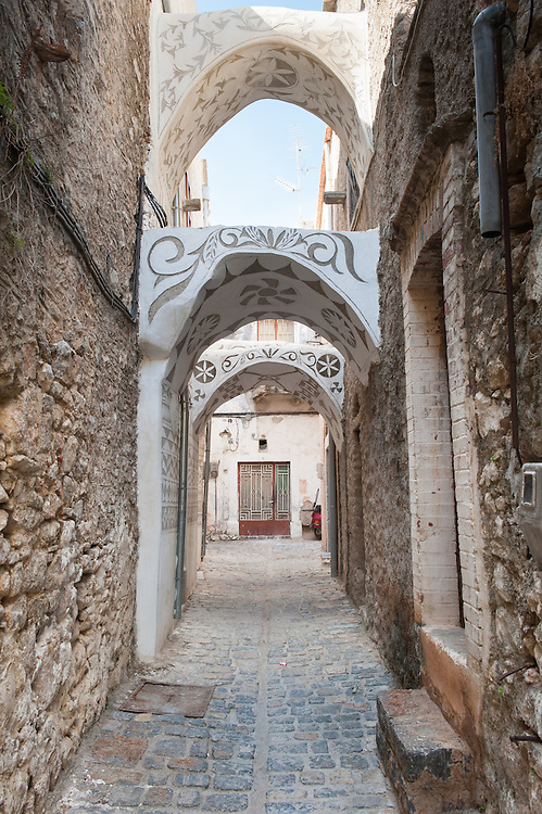 The streets of the medieval village of Pyrgi in Chios with houses covered with xysta (sgraffito) decorative motives.<br /> <br /> Pyrgi in Chios is known as the &quot;painted village&quot; on account of the decoration of the houses. The village still keeps its medieval style and together with the other Mastichochoria (Mastic Villages) are in the list of the Intangible Cultural Heritage of Humanity of UNESCO