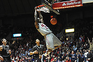 Ole Miss' Murphy Holloway (31) dunks against Texas A&M's Jordan Green (13) in Oxford, Miss. on Wednesday, February 27, 2013. (AP Photo/Oxford Eagle, Bruce Newman)