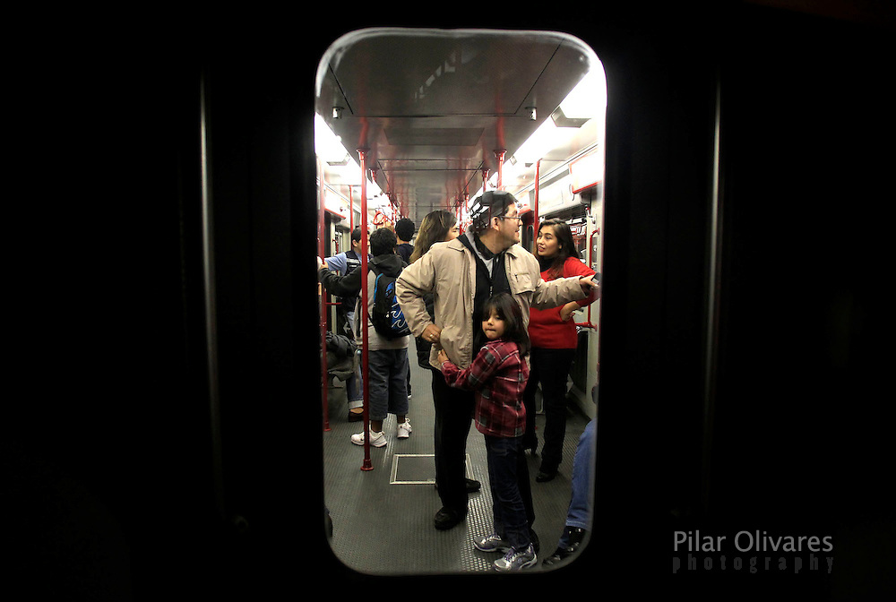 Passengers travel inside the electric train during the train testing in Lima. (photo: PIlar Olivares)