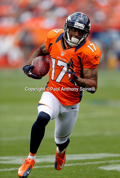Denver Broncos wide receiver Andre Caldwell (17) runs a first quarter reverse for a first down during the NFL week 4 football game against the Oakland Raiders on Sunday, Sept. 30, 2012 in Denver. The Broncos won the game 37-6. ©Paul Anthony Spinelli