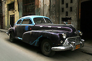 Old purple and blue car in Havana Centro, Cuba.