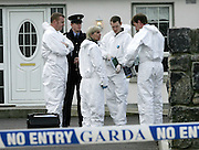 3/4/2006.Dr Marie Cassady the State Pathologist with Gardai and members of the Crime Scene Investigation unit pictured at the scene where a man was shot on the outskirts of Clonmel..Picture Dylan Vaughan.