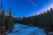 The Space Station rises out of the northwest in a twilight pass over the Kicking Horse River, in Yoho National Park, BC, on June 7, 2016. I would have caught the start of the pass but this one took me my surprise so I missed the first minute or so.<br /> <br /> This is a stack of 3 exposures for the length of trail here, each 10 seconds at f/2.8 with the 20mm lens and Nikon D750 at ISO 400.