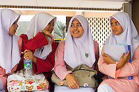 Malaysian School Girls Wearing Islamic School Uniforms.