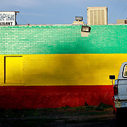 """SHOT 8/3/09 7:24:03 PM - An Ethiopian Restaurant on Colfax Avenue in Denver, Co. The street is well known for ethnic restaurants of all types. Colfax Avenue is the main street that runs east and west through the Denver-Aurora metropolitan area in Colorado. As U.S. Highway 40, it was one of two principal highways serving Denver before the Interstate Highway System was constructed. In the local street system, it lies 15 blocks north of the zero point (Ellsworth Avenue, one block south of 1st Avenue). For that reason it would normally be known as """"15th Avenue"""" but the street was named for the 19th-century politician Schuyler Colfax. On the east it passes through the city of Aurora, then Denver, and on the west, through Lakewood and the southern part of Golden. Colfax Avenue cuts through Original Aurora, the city's historic core, and skirts the southern edge of downtown Denver. Because of the dense, mixed-use character of the development along Colfax Avenue, the Regional Transportation District bus route 15 - East Colfax has the highest ridership in the RTD system. Colloquially, the arterial is referred to simply as """"Colfax"""", a name that has become associated with prostitution, crime, and a dense concentration of liquor stores and inexpensive bars. Playboy magazine once called Colfax """"the longest, wickedest street in America."""" However, such activities are actually isolated to short stretches of the 26-mile (42 km) length of the street. Periodically, Colfax undergoes redevelopment by the municipalities along its course that bring in new housing, trendy businesses and restaurants. Some say that these new developments detract from the character of Colfax, while others worry that they cause gentrification and bring increased traffic to the area.(Photo by Marc Piscotty / © 2009)"""