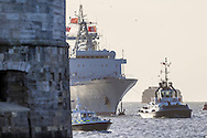 The Chinese Naval replenishment ship Chaohu passes the Round Tower as it enters Portsmouth harbour today. The ship is involved in the first visit by the Chinese Navy to the UK since 2007. She is accompanied by the frigate Yun Cheng and the assault ship Chang Bai Shan. They arrived in Portsmouth 24 hours early due to the expected bad weather. The Royal Navy statement stated that the five day formal visit is aimed at enhancing military understanding between the UK and China. Picture date Sunday 11th January, 2015.<br /> Picture by Christopher Ison. Contact +447544 044177 chris@christopherison.com