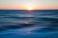 The sun sets over the Atlantic Ocean as P&amp;O Cruises'  Britannia sails to Alicante.<br /> Picture date: Monday June 15, 2015.<br /> Photograph by Christopher Ison &copy;<br /> 07544044177<br /> chris@christopherison.com<br /> www.christopherison.com