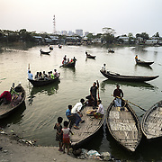 Local boat transport on the Gulshan-Bannani Lake, which take people to and from Korail, Dhaka's largest and longest standing slum.Korail slum has an estimated population of over 40,000 people. The shantytown is located on the edges of the Gulshan-Bannani Lake.On April 4th 2012 some of the illegal settlement was destroyed by bulldozers following a court order dated back to January 2012.According to the Guardian newspaper, around 2,000 illegal structures, including houses and shops were removed, and 170 acres of public land reclaimed.