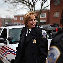 Police Chief Cathy L. Lanier converses with a police officer while on patrol in Washington, D.C. on March 16, 2009. Lanier, chief of police with the Metropolitan Police Department of the District of Columbia, MPDC, rose to her position from humble beginnings: she was a high-school dropout after ninth grade and an unwed mother at the age of 15. Despite a rough start, she later earned advanced academic degrees from the Johns Hopkins University and the Naval Postgraduate School in Monterey, Calif., where she completed a Masters in Security Studies. Lanier also attended the John F. Kennedy School of Government at Harvard University and is a graduate of the FBI Academy and the University of the District of Columbia. She has been on the force for 18 years.
