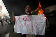 Demonstrators clash with Egyptian police in Cairo, Egypt January 28,2011. (Photo by Heidi Levine/Sipa Press).