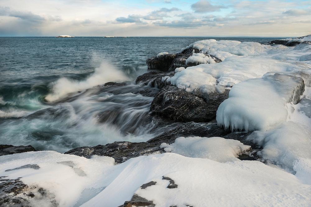 Lake Superior waves crash onto the Black Rocks of Presque Isle <br /> Marquette, Michigan