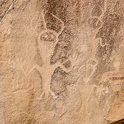 Petroglyph on the Utah side of Dinosaur National Monument. Dinosaur National Monument is on the southeast flank of the Uinta Mountains straddling Colorado and Utah at the confluence of the Green and Yampa Rivers. Although most of the monument is in Moffat County, Colorado, the popular Dinosaur Quarry is in Utah near the town of Jensen, USA.