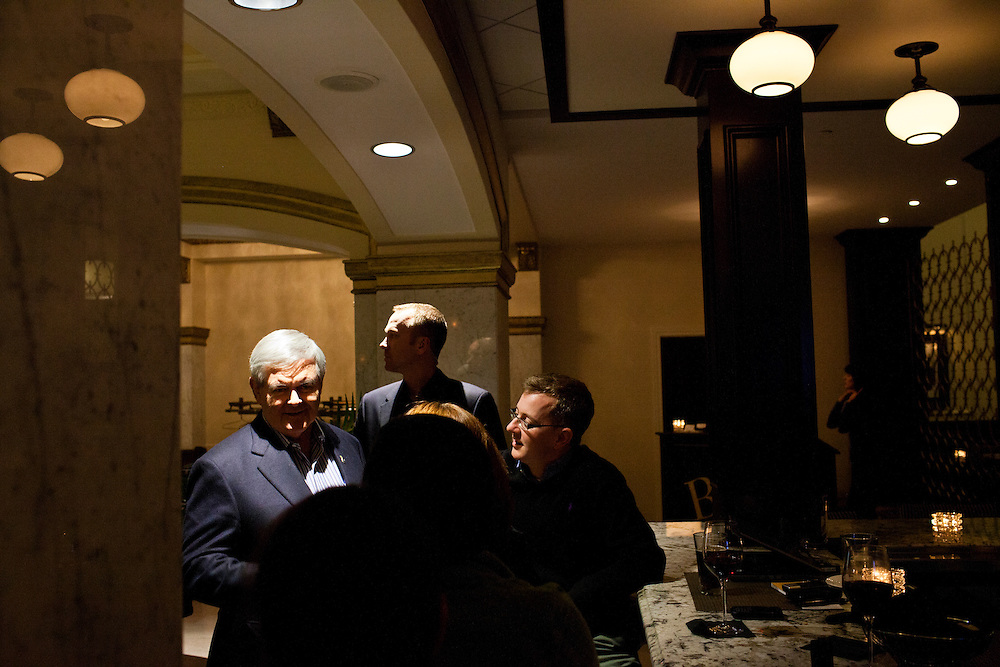Republican presidential candidate Newt Gingrich talks to reporters at the hotel bar after a campaign stop at the Hotel Blackhawk on Monday, January 2, 2012 in Davenport, IA.