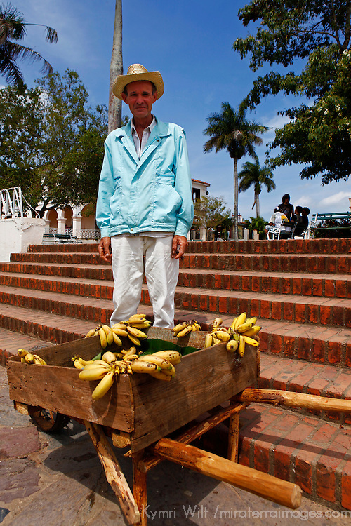 Central America, Cuba, Vinales. Local Cuban man sells bananas from his farm.