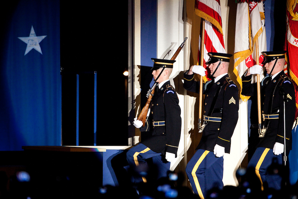 WASHINGTON - JANUARY 21: A military color guard presents the flag prior to President Barack Obama and First Lady Michelle Obama appearing at the Southern Inaugural Ball on January 21, 2009 in Washington, DC. Obama was sworn in as the 44th President of the United States, becoming the first African American to be elected President of the US. (Photo by Brendan Hoffman/Getty Images)