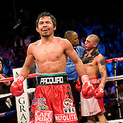 Manny Pacquiao beats Miguel Angel Cotto