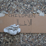 A sign reads 'children' in English and Arabic at the former refugee camp in the port of Lakki. <br /> <br /> The camp was opened by volunteers in the summer of 2015 and later that year UNHCR and MSF expanded it and provided additional tents, toilets and other facilities. The camp was closed soon after the opening of a 'Hotspot' (EU-run migrant's reception centres) camp in Lepida in February 2016.