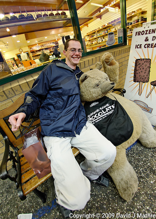 Andrew with the Gimme Some Chocolate Bear in front of Ghirardelli's Chocolate Shop in San Francisco. Image taken with a Nikon D700 and 16 mm f/2.8 fisheye lens (ISO 1600, 16 mm, f/2.8, 1/60 sec). Raw image processed with DxO Optics Pro, Focus Magic, Nik Define, and Photoshop CS5.