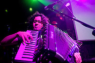 A musician plays the accordian during a live music show at La Juliana, a top dance club in Quito, Ecuador.