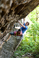 Rock Climber Cole Fennel ascending a newly discovered rock wall in Newton County, Arkansas.