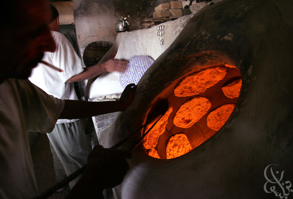 Iraqi bakers prepare traditional Iraqi flat bread at the Sacred Karbala bakery May 06, 2005 in Baghdad, Iraq.  Many Iraqis spend their Friday afternoons with family and friends or running personal and family errands.