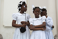 Haitian girls stand outside the Notre-Dame Cathedral after mass. Cap Haitian, January 27, 2008.