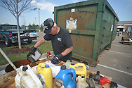 Willie Willcott of Young's Oil Service in Oakman, Ala. works the Household Hazardous Waste Collection Day at the Oxford Conference Center in Oxford, Miss. on Saturday, April 9, 2011.