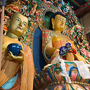 Carved Buddha shrines decorate Tengboche Monastery (12,690 feet elevation), which was first built in 1918 by Tibetan Buddhists, then rebuilt in 1934 and 1993 after earthquake & fire. Sagarmatha National Park, Nepal. Sagarmatha National Park was created in 1976 and honored as a UNESCO World Heritage Site in 1979.