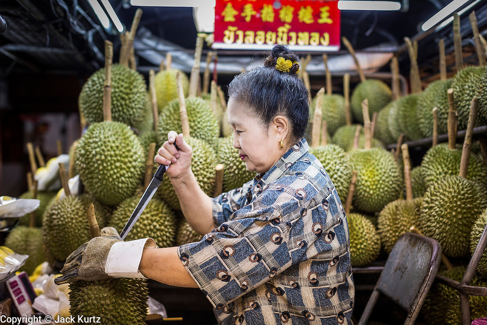 18 SEPTEMBER 2013 - BANGKOK, THAILAND:  A woman sells durian from the back of a pickup truck in the Chinatown section of Bangkok. Thailand in general, and Bangkok in particular, has a vibrant tradition of street food and eating on the run. In recent years, Bangkok's street food has become something of an international landmark and is being written about in glossy travel magazines and in the pages of the New York Times.     PHOTO BY JACK KURTZ