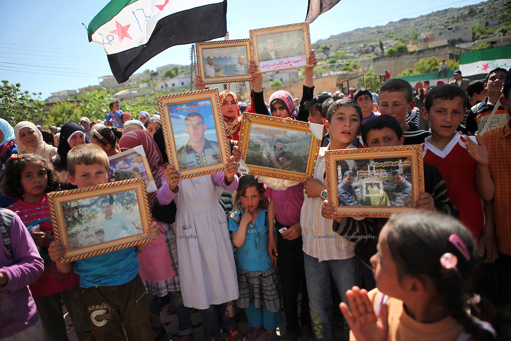 A protest gathering of 500 women and men to demonstrate against syrian Assad regime in the village of Bashirija which was beeing attacked by syrian Army in early April, leaving serveral people dead. Many houses were set on fire and livestock were shot dead by Assad loyal forces raging for two days. Later nighbours buried bodies of inhabitants hasty in a mass grave.