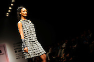 A model wears a creation by Atsu during the New Delhi Fashion Week in New Delhi, India March 20, 2009. Photo by Keith Bedford