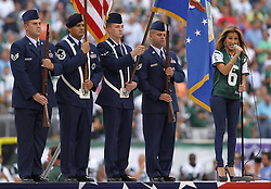 Sept 19, 2011; East Rutherford, NJ, USA; Adrienne Bailon sings the National Anthem before the start of the Jets-Patriots game at the New Meadowlands Stadium.