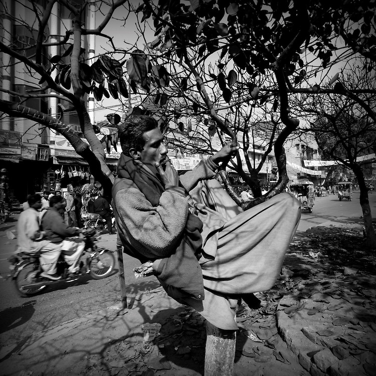 Man is waiting for job. Lyari, the oldest part of Karachi, a kind of no man's land where smugglers, junkies, terrorists and general bad guys roam freely.