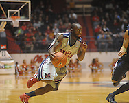 """Ole Miss guard Chris Warren (12) dribbles at the C.M. """"Tad"""" Smith Coliseum on Friday, November 26, 2010. Ole Miss won 84-71."""