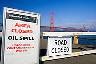 Road closure near Fort Point due to November 7, 2007 Oil Spill in San Francisco. Road sign with Golden Gate Bridgge in the background.