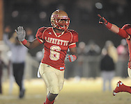 Lafayette High's Jamel Dennis (6) celebrates a Commodore fumble recovery vs. Louisville in MHSAA 4A playoff action at William L. Buford Field in Oxford, Miss. on Friday, November 18, 2011. Lafayette won 28-6 and will advance to play Amory.