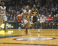 """Ole Miss guard Dundrecous Nelson (5)  steals the ball from Southern Mississippi forward Ahyaro Phillips (25) at C.M. """"Tad"""" Smith Coliseum in Oxford, Miss. on Saturday, December 4, 2010. (AP Photo/Oxford Eagle, Bruce Newman)"""