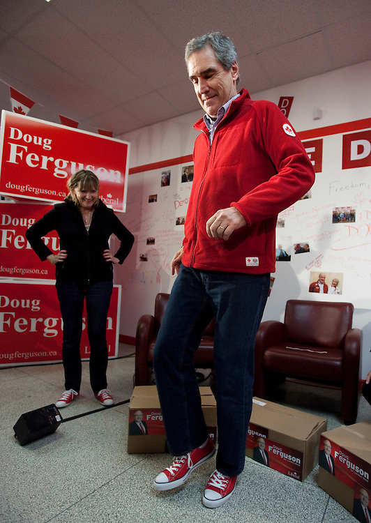 Liberal leader Michael Ignatieff tries on some new red converse shoes for the last days at the campaign during a campaign stop in London, Ontario, Friday April 29, 2011.<br /> REUTERS/Geoff Robins (CANADA)