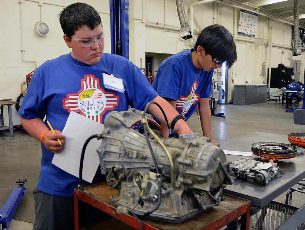 jt033117f/a sec/jim thompson/  left to right- Jay Richardson from Silver High School and Moises Trevizo from Carlsbad High School go over the automatic transmission station in the automotive section at the SkillsUSA  competition on the CNM Main campus in Albuquerque, NM. Friday March 31, 2017. (Jim Thompson/Albuquerque Journal)
