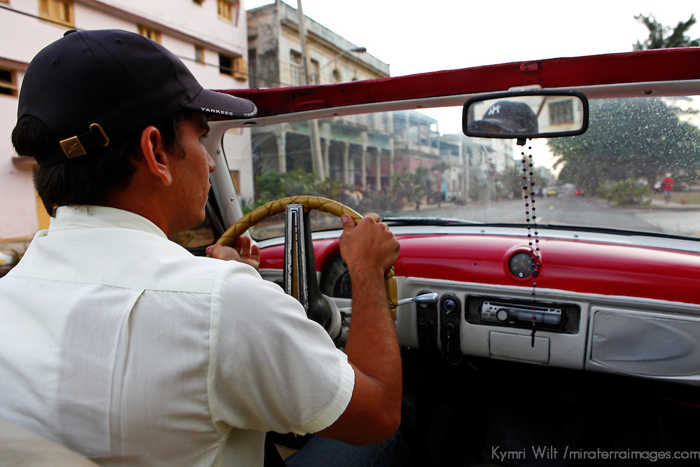 Central America, Cuba, Havana. Classic Convertible driver in Havana.