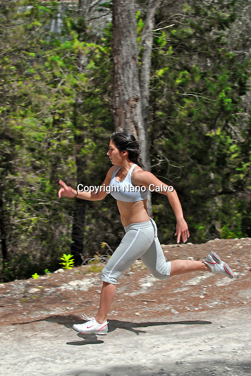 Fit young woman running in forest