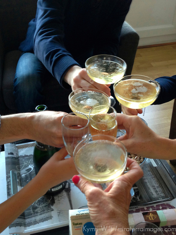Europe, France. Friends toasting with champagne.