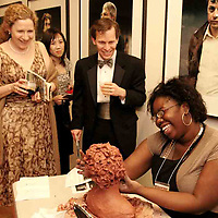 (left to right) Kristine Kunesh-Part, Sarah and John Kunesh watch and chat with Lauren Scott as she works on sculpture she says is a self-portrait at the 2007 Arts Gala at Wright State University, Saturday evening..