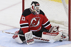 Apr 7; Newark, NJ, USA; New Jersey Devils goalie Martin Brodeur (30) makes a save during the third period at the Prudential Center. The Devils defeated the Senators 4-2.