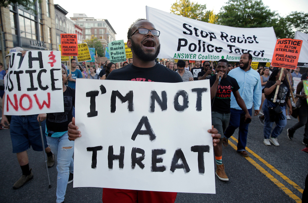 Demonstrators with Black Lives Matter march during a protest in Washington, U.S., July 9, 2016.      REUTERS/Joshua Roberts