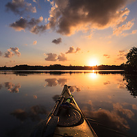 A beautiful sunset as seen from a kayak floating in Hidden Lake near the western shore of Biscayne Bay in Miami, Florida.